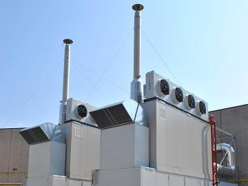 Due container di un impianto di cogenerazione in una azienda tessile in provincia di Bergamo